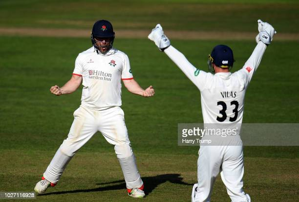 Steven Croft and Dane Vilas of Lancashire celebrate the final wicket as the match ends in a tie during Day Two of the Specsavers County Championship...