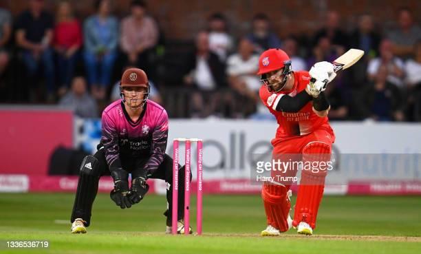 Steven Croft of Lancashire Lightning plays a shot as Tom Banton of Somerset looks on during the Vitality T20 Blast Quarter Final match between...