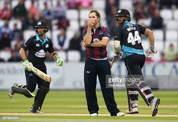 Steven Crook of Northamptonshire looks on as Daryl Mitchell and Ross Whiteley of Worcestershire pile on the runs during the NatWest T20 Blast match...