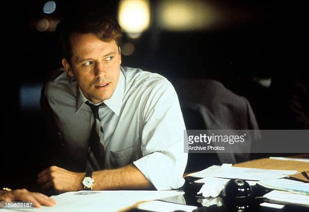 Steven Culp at a desk in a scene from the film 'Thirteen Days' 2000