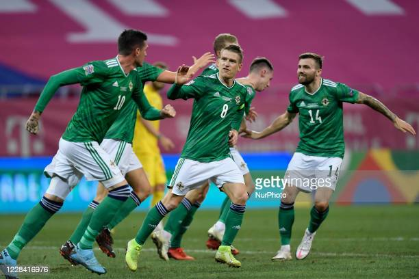 Steven Davis celebrates with Kyle Lafferty and Stuart Dallas of Northern Ireland during UEFA Nations League 2021 match between Romania and Northern...