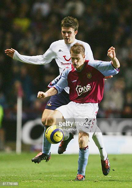 Steven Davis of Aston Villa is tackled by Michael Carrick of Tottenham Hotspur during the Barclays Premiership match between Aston Villa and...