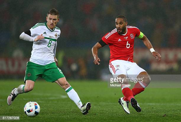 Steven Davis of Northern Ireland and Ashley Williams of Wales in action during the international friendly match between Wales and Northern Ireland at...