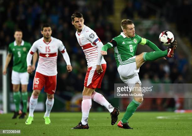 Steven Davis of Northern Ireland and Granit Xhaka of Switzerland in action during the FIFA 2018 World Cup Qualifier PlayOff First Leg between...