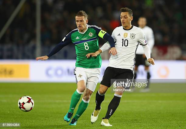 Steven Davis of Northern Ireland and Mesut Oezil of Germany in action during the FIFA 2018 World Cup Qualifier between Germany and Northern Ireland...