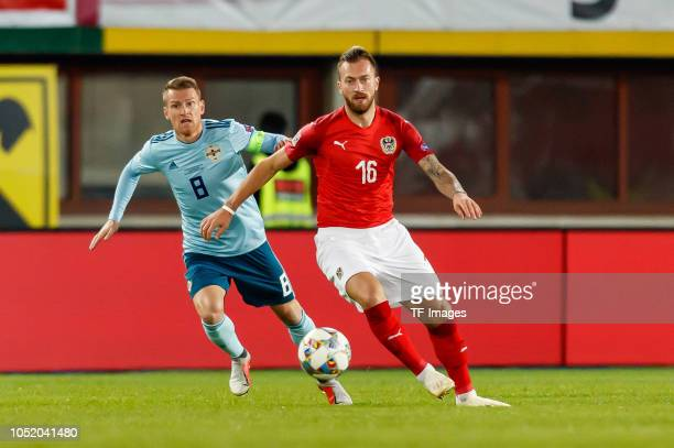 Steven Davis of Northern Ireland and Peter Zulj of Austria battle for the ball during the UEFA Nations League B group three match between Austria and...