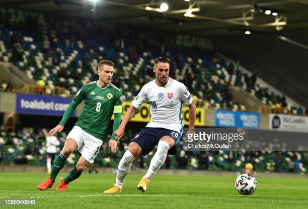 Steven Davis of Northern Ireland battles for possession with Robert Mak of Slovakia during the UEFA EURO 2020 Play-Off Final between Northern Ireland...