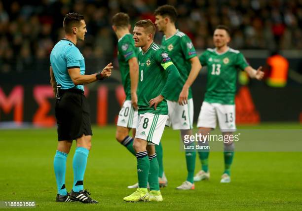 Steven Davis of Northern Ireland discusses with referee Carlos Del Cerro Grande of Spain during the UEFA Euro 2020 Qualifier between Germany and...