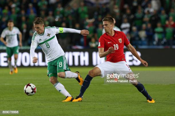 Steven Davis of Northern Ireland in action against Markus Henriksen of Norwayduring the FIFA 2018 World Cup Qualifier between Norway and Northern...