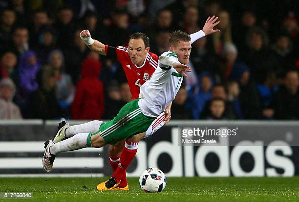 Steven Davis of Northern Ireland is brought down by David Vaughan of Wales during the international friendly match between Wales and Northern Ireland...