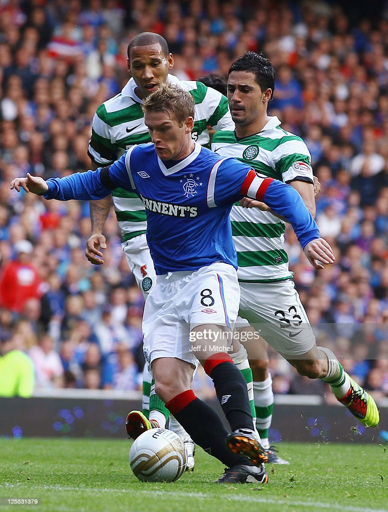 Steven Davis of Rangers is tackled by Beram Kayal of Celtic during the Clydesdale Bank Premier League match between Rangers and Celtic at Ibrox Stadium on September 18, 2011 in Glasgow, Scotland.