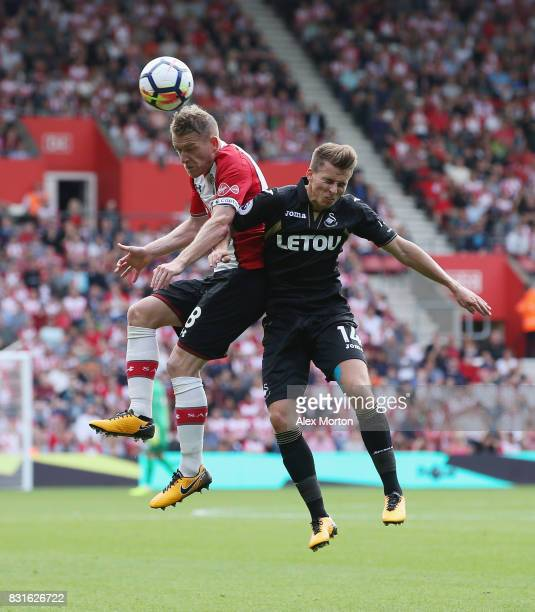 Steven Davis of Southampton and Tom Carroll of Swansea City during the Premier League match between Southampton and Swansea City at St Mary's Stadium...