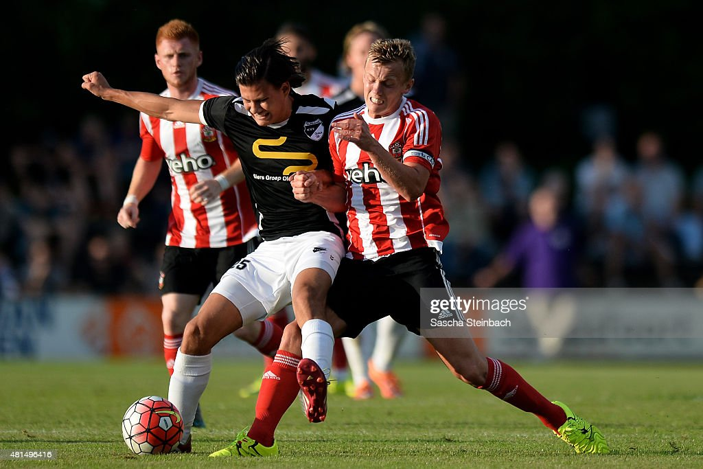 Steven Davis (R) of Southampton battle for the ball during the friendly match between KVV Quick 1920 and FC Southampton at Sportpark De Vondersweijde on July 21, 2015 in Oldenzaal, Netherlands.
