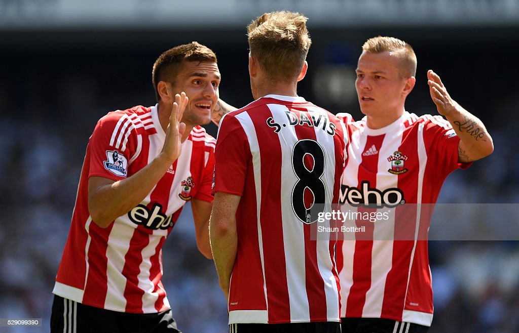 Steven Davis of Southampton celebrates with team mates after scoiring his teams first goal during the Barclays Premier League match between Tottenham Hotspur and Southampton at White Hart Lane on May 8, 2016 in London, England.