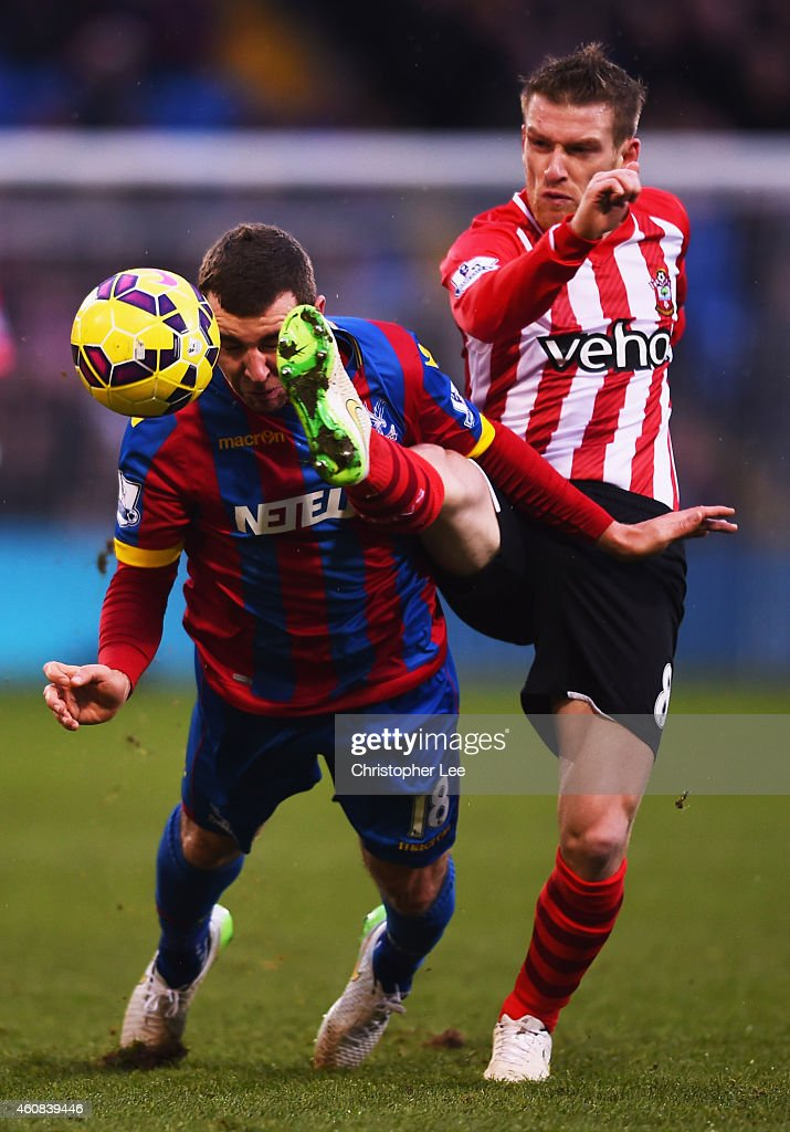 Steven Davis of Southampton challenges James McArthur of Crystal Palace during the Barclays Premier League match between Crystal Palace and Southampton at Selhurst Park on December 26, 2014 in London, England.
