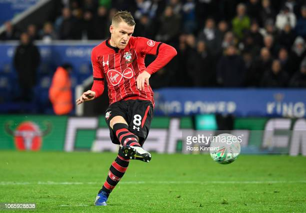 Steven Davis of Southampton scores a penalty during a penalty shoot out during the Carabao Cup Fourth Round match between Leicester City and...