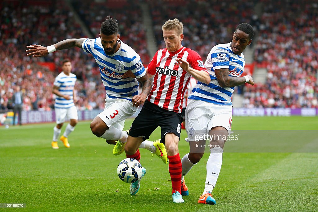 Steven Davis (C) of Southampton vies with Armand Traore (L) and Leroy Fer of QPR during the Barclays Premier League match between Southampton and Queens Park Rangers at St Mary's Stadium on September 27, 2014 in Southampton, England.