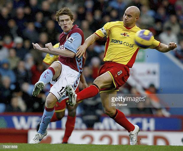 Steven Davis of Villa gets the ball past the challenge of Gavin Mahon of Watford during the Barclays Premiership match between Aston Villa and...