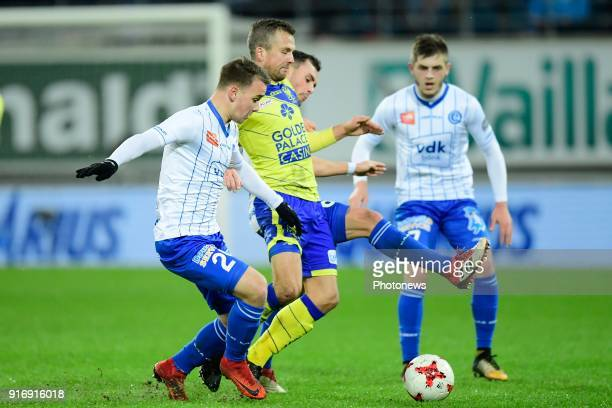 Steven De Petter midfielder of STVV is challenged by Nicolas Raskin midfielder of KAA Gent and Birger Verstraete midfielder of KAA Gent during the...