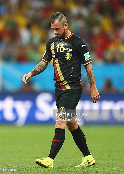 Steven Defour of Belgium walks off the pitch as he receives a read card during the 2014 FIFA World Cup Brazil Group H match between Korea Republic...