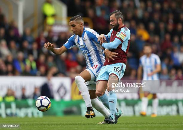 Steven Defour of Burnley and Abdelhamid Sabiri of Huddersfield Town battle for possession during the Premier League match between Burnley and...