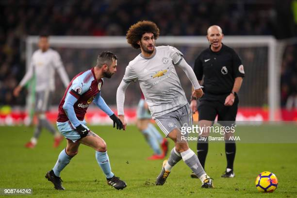Steven Defour of Burnley and Marouane Fellaini of Manchester United during the Premier League match between Burnley and Manchester United at Turf...
