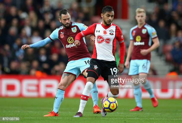 Steven Defour of Burnley and Sofiane Boufal of Southampton battle for the ball during the Premier League match between Southampton and Burnley at St...