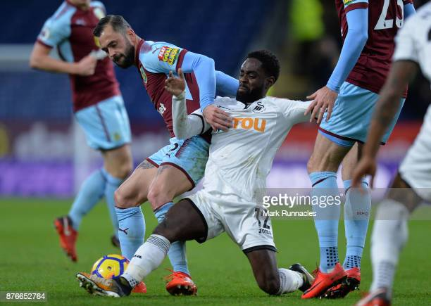 Steven Defour of Burnley is tackled by Nathan Dyer of Swansea City during the Premier League match between Burnley and Swansea City at Turf Moor on...