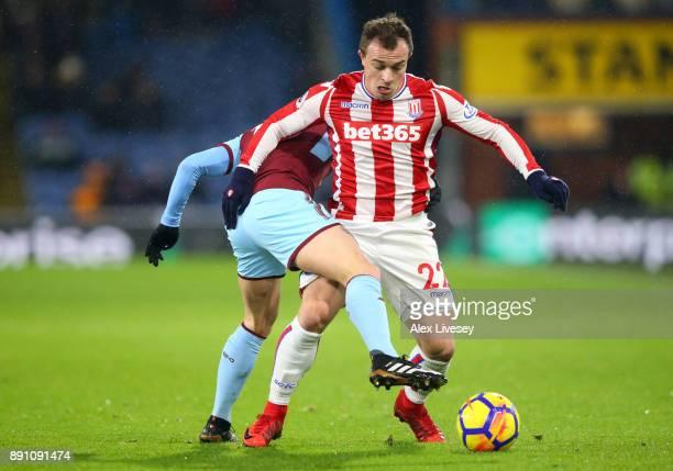 Steven Defour of Burnley tackles Xherdan Shaqiri of Stoke City during the Premier League match between Burnley and Stoke City at Turf Moor on...