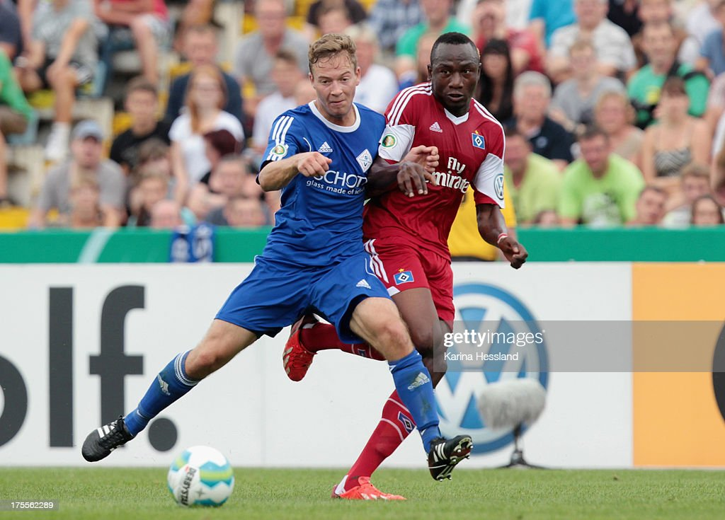 Steven Dietzsch of Jena and Jacques Daogari Zoua of Hamburg battle for the ball during the DFB Cup between SV Schott Jena and Hamburger SV at Ernst-Abbe-Sportfeld on August 04, 2013 in Jena,Germany.