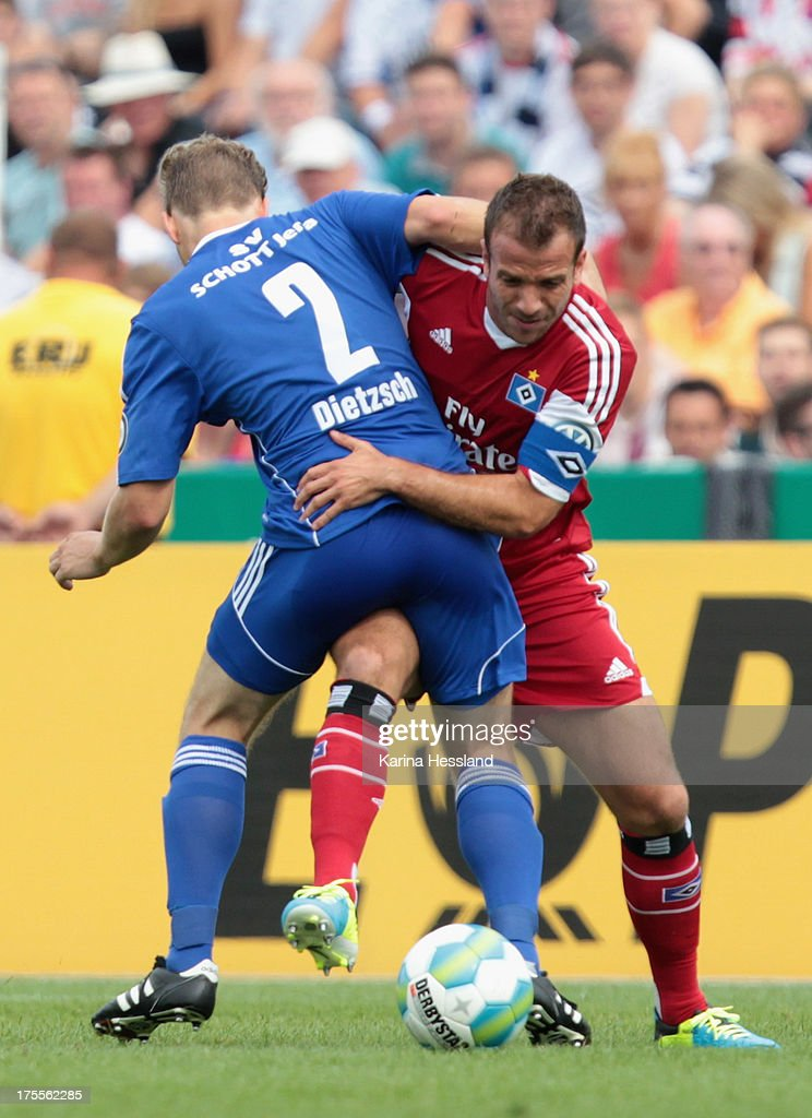 Steven Dietzsch of Jena and Rafael van der Vaart of Hamburg battle for the ball during the DFB Cup between SV Schott Jena and Hamburger SV at Ernst-Abbe-Sportfeld on August 04, 2013 in Jena,Germany.