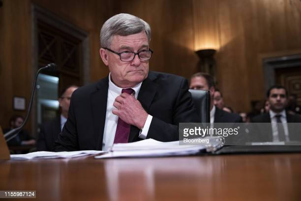 Steven Dillingham director of US Census Bureau adjusts his tie during a Senate Homeland Security and Governmental Affairs Committee hearing in...