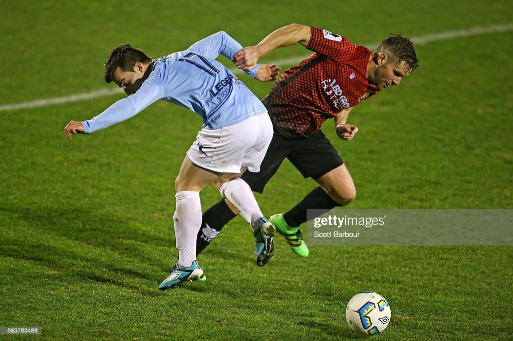 Steven Drewery of Marconi Stallions and Tom Cahill of Hume City compete for the ball during the FFA Cup round of 32 match between Hume City and Marconi Stallions at ABD Stadium on July 27, 2016 in Melbourne, Australia.