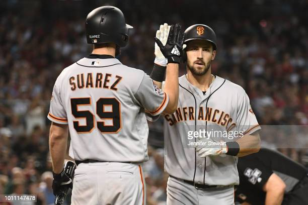 Steven Duggar of the San Francisco Giants is congratulated by Andrew Suarez after hitting a solo home run in the fourth inning of the MLB game...