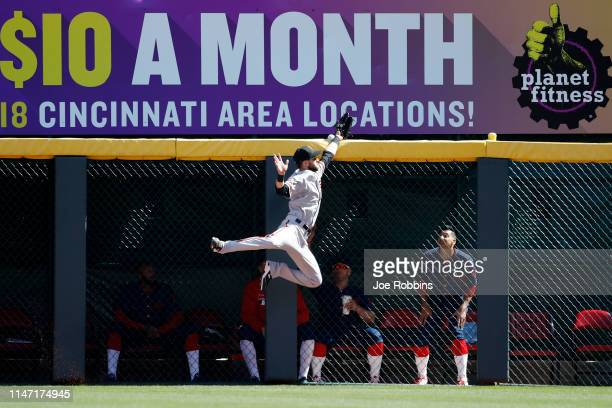 Steven Duggar of the San Francisco Giants leaps at the right field wall but is not able to catch a home run off the bat of Eugenio Suarez of the...