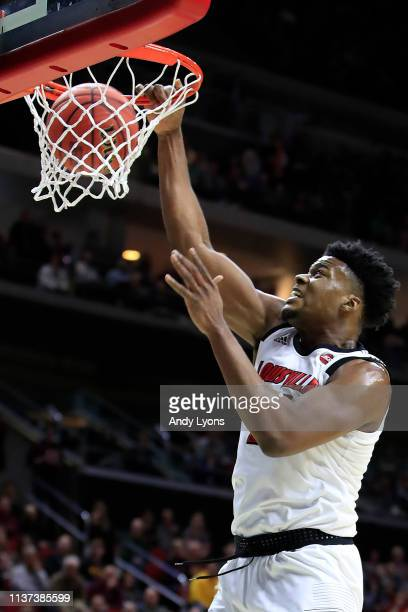 Steven Enoch of the Louisville Cardinals dunks the ball against the Minnesota Golden Gophers during their game in the First Round of the NCAA...