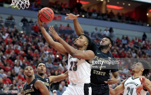 Steven Enoch of the Louisville Cardinals shoots the ball against the Florida State Seminoles at KFC YUM Center on January 04 2020 in Louisville...