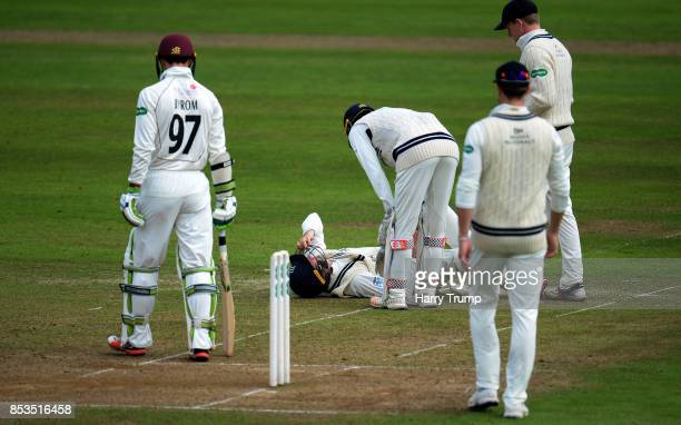 Steven Eskinazi of Middlesex lies on the floor after being hit by a shot from Eddie Byrom of Somerset during Day One of the Specsavers County...