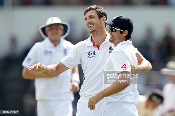 Steven Finn and Alastair Cook of England celebrate the wicket of Brendon McCullum of New Zealand during day three of the second Test match between...