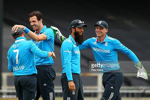 Steven Finn and Ian Bell of England celebrate the wicket of Stuart Binny of India during the One Day International match between England and India at...