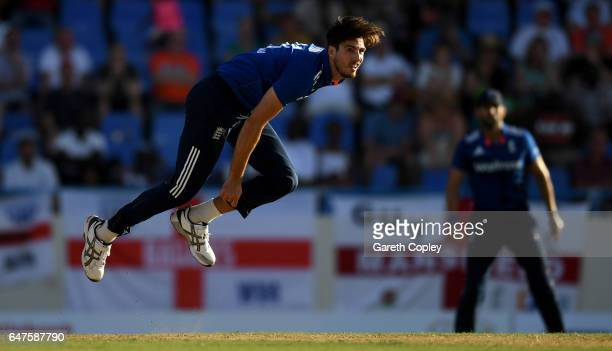 Steven Finn of England bowls during the first One Day International between the West Indies and England at Sir Vivian Richards Cricket Ground on...
