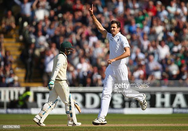 Steven Finn of England celebrates after taking the wicket of Michael Clarke of Australia during day two of the 3rd Investec Ashes Test match between...