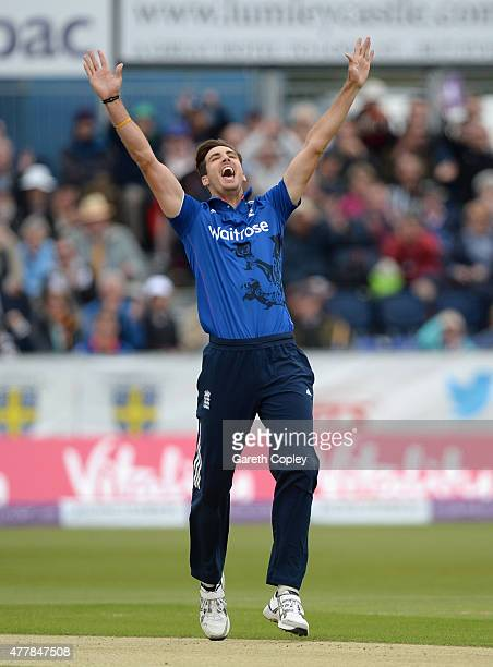 Steven Finn of England celebrates bowling Brendon McCullum of New Zealand during the 5th ODI Royal London OneDay match between England and New...