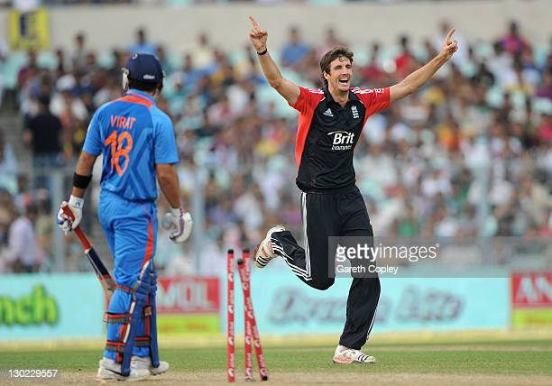 Steven Finn of England celebrates bowling Virat Kohli of India during the 5th One Day International between India and England at Eden Gardens on...