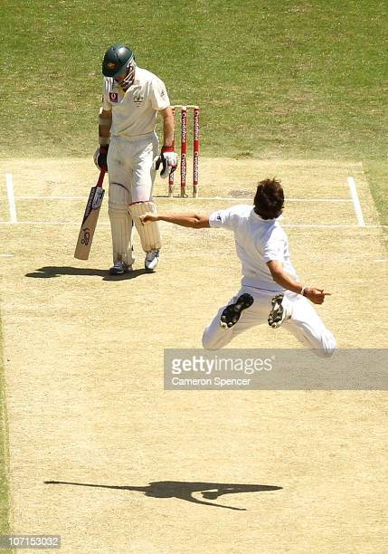Steven Finn of England celebrates dismissing Simon Katich of Australia during day two of the First Ashes Test match between Australia and England at...