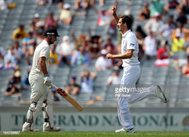 Steven Finn of England celebrates his wicket of Hamish Rutherford of New Zealand during day one of the Third Test match between New Zealand and...