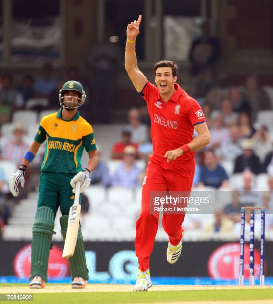 Steven Finn of England celebrates taking the wicket of Hashim Amla of South Africa during the ICC Champions Trophy Semi Final match between England...
