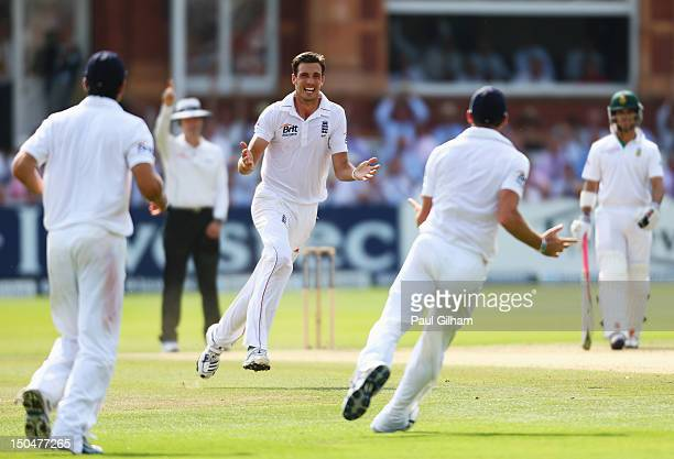 Steven Finn of England celebrates taking the wicket of Jacques Rudolph of South Africa for 11 runs during day four of the third Investec test match...