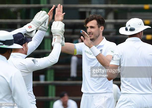 Steven Finn of England celebrates the wicket of Hashim Amla of the Proteas with his team mates during day 1 of the 3rd Test match between South...