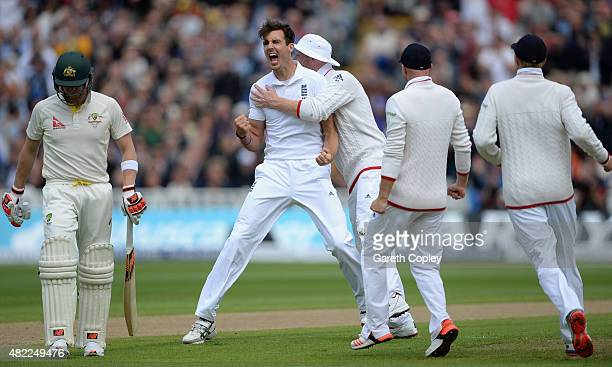 Steven Finn of England celebrates with teammates after dismissing Steven Smith of Australia during day one of the 3rd Investec Ashes Test match...